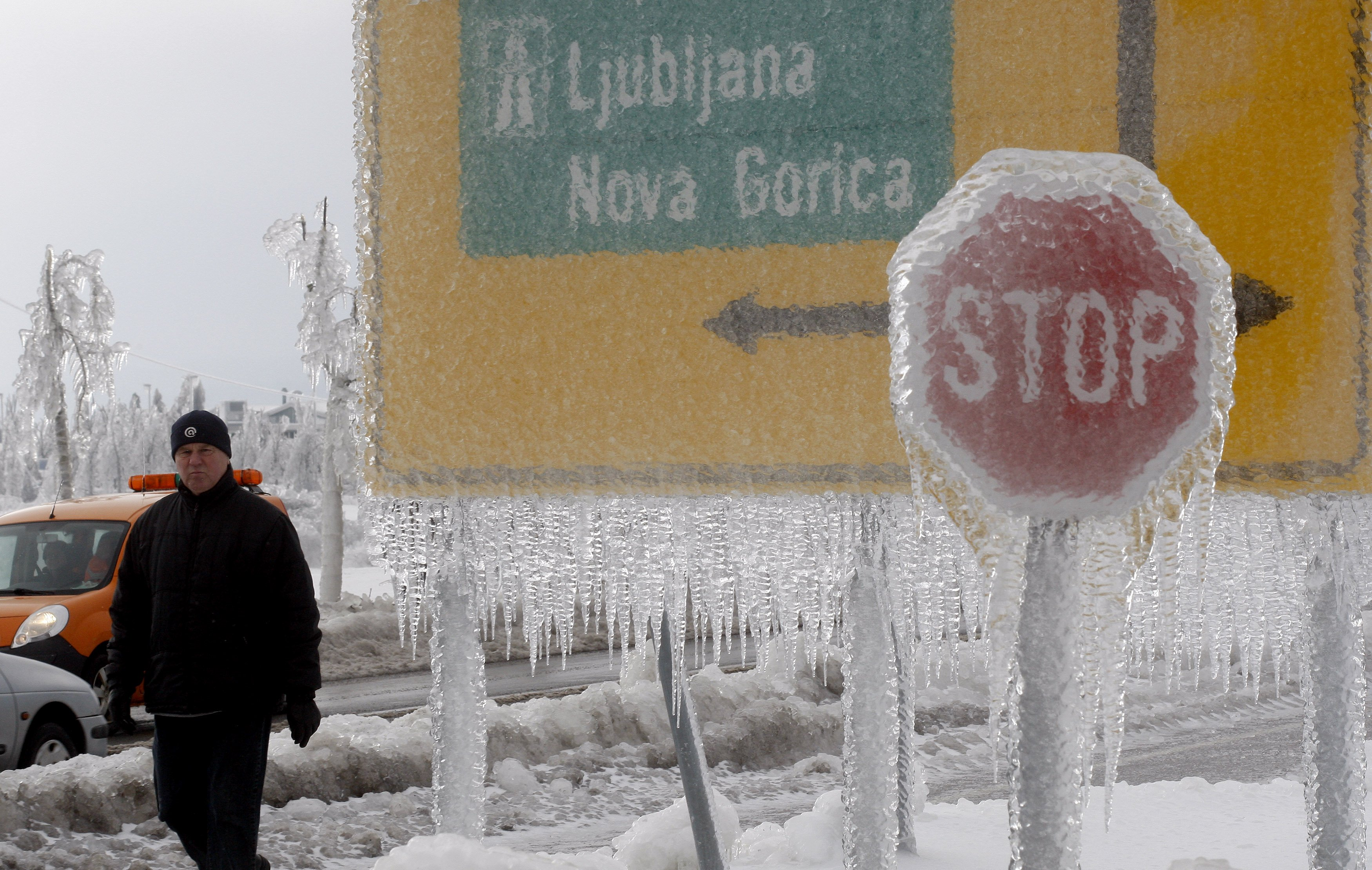 Road signs coated in a thick layer of ice.