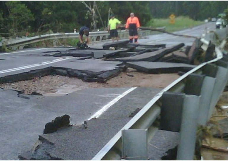 Bridge leading into Cooroy has been destroyed by rising waters. (Source: The Courier-Mail)