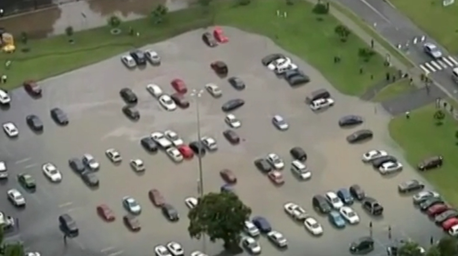 Parking lot swamped by water. (Source: Seven Network)