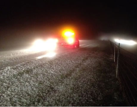 Interstate 74 totally covered by hail, with ruts. Snowplows had to come in and clear away the hail. (Source: WTHR news)